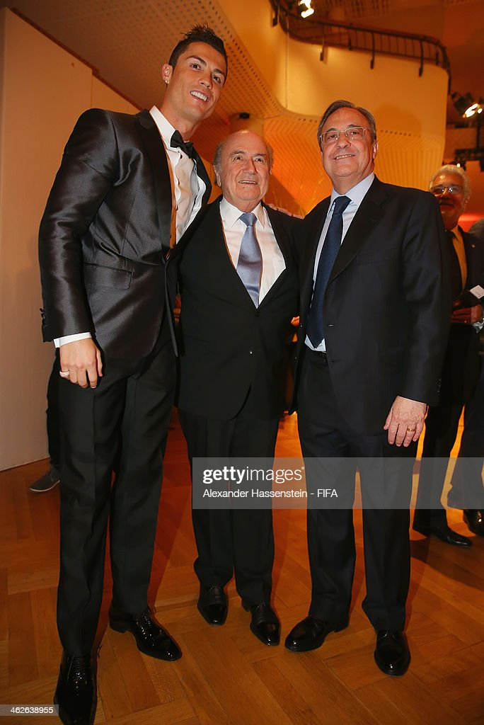 Ballon d'Or nominee Cristiano Ronaldo of Portugal and Real Madrid poses with FIFA President Joseph S. Blatter and Real Madrid president Florentino Perez during the FIFA Ballon d'Or Gala 2013 at the Kongresshaus on January 13, 2014 in Zurich, Switzerland.