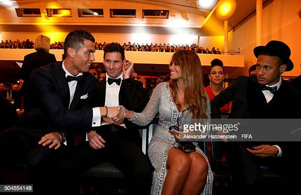 Ballon d'Or nominee Cristiano Ronaldo of Portugal and Real Madrid shakes hands with Antonella Roccuzzo as he sits with fellow nominees Lionel Messi...