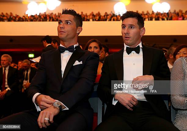 Ballon d'Or nominee Cristiano Ronaldo of Portugal and Real Madrid sits with FIFA Ballon d'Or nominee Lionel Messi of Argentina and Barcelona during...