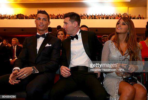 Ballon d'Or nominee Cristiano Ronaldo of Portugal and Real Madrid sits with fellow nominee Lionel Messi of Argentina and Barcelona and Antonella...