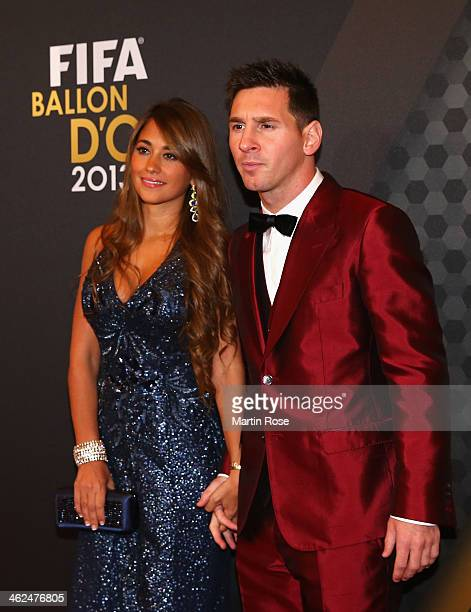 Ballon d'Or nominee Lionel Messi of Argentina and Barcelona and Antonella Roccuzzo arrive during the FIFA Ballon d'Or Gala 2013at the Kongresshalle...