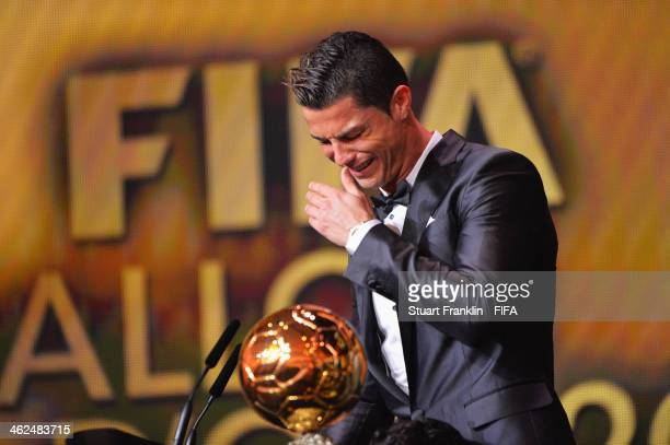 Ballon d'Or winner Cristiano Ronaldo of Portugal and Real Madrid gets emotional as he collects his award during the FIFA Ballon d'Or Gala 2013 at the...