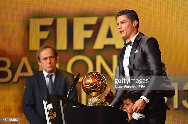 Ballon d'Or winner Cristiano Ronaldo of Portugal and Real Madrid gets emotional as he collects his award with his son Cristiano Ronaldo Junior with...