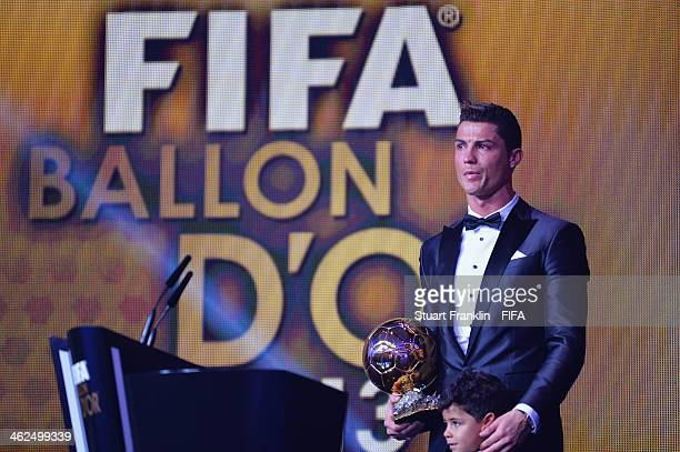 Ballon d'Or winner Cristiano Ronaldo of Portugal and Real Madrid gets emotional as he collects his award with his son Cristiano Ronaldo Junior during...