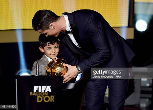 Ballon d'Or winner Cristiano Ronaldo of Portugal and Real Madrid accepts his award with son Cristiano Ronaldo Junior during the FIFA Ballon d'Or Gala...