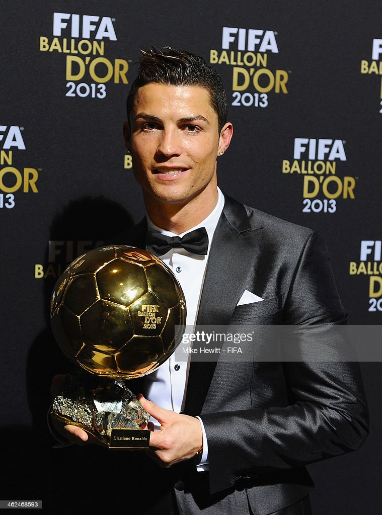 Ballon d'Or winner Cristiano Ronaldo of Portugal and Real Madrid poses with his award after the FIFA Ballon d'Or Gala 2013 at the Kongresshaus on January 13, 2014 in Zurich, Switzerland.