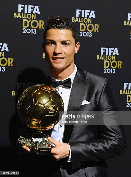 Ballon d'Or winner Cristiano Ronaldo of Portugal and Real Madrid poses with his award after the FIFA Ballon d'Or Gala 2013 at the Kongresshaus on...