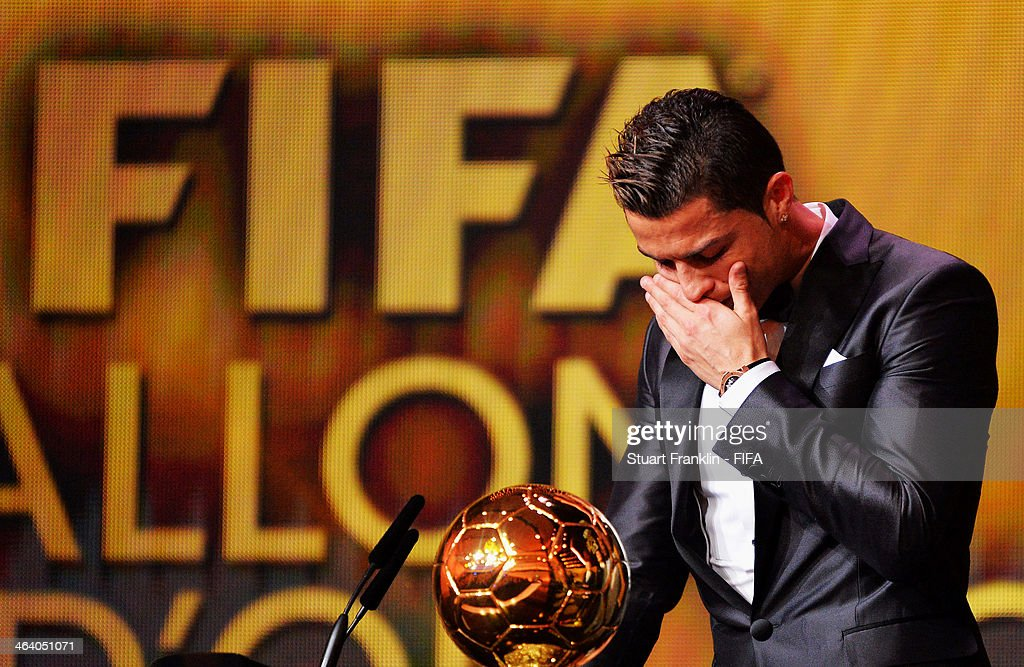 Ballon d'Or winner Cristiano Ronaldo of Portugal gets emotional as he collects his award during the FIFA Ballon d'Or Gala 2013 at the Kongresshaus on January 13, 2014 in Zurich, Switzerland.