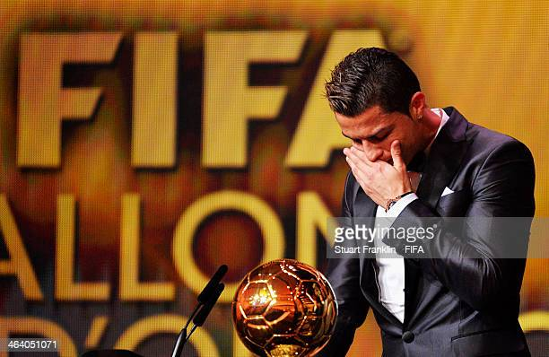Ballon d'Or winner Cristiano Ronaldo of Portugal gets emotional as he collects his award during the FIFA Ballon d'Or Gala 2013 at the Kongresshaus on...