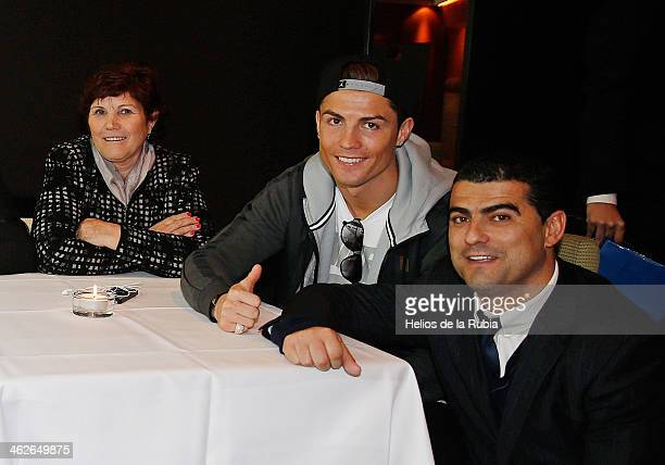 Ballon d'Or winner Cristiano Ronaldo poses with his parents Hugo Aveiro and Dolores Aveiro after the Ballon d'Or competition January 13, 2014 in...