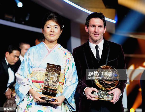 Ballon d'Or winner Lionel Messi and FIFA Women's World Player of the Year winner Homare Sawa of Japan pose with their trophies after the FIFA Ballon...