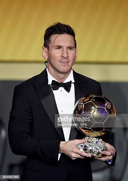 Ballon d'Or winner Lionel Messi of Argentina and Barcelona accepts his award during the FIFA Ballon d'Or Gala 2015 at the Kongresshaus on January 11,...