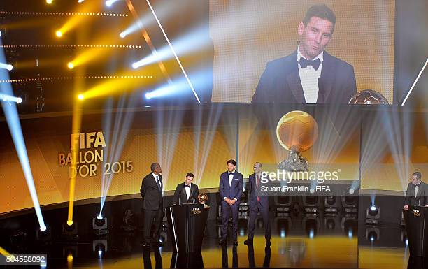 Ballon d'Or winner Lionel Messi of Argentina and Barcelona accepts his award with FIFA Acting President Issa Hayatou, Kaka of Brazil and Amaury Sport...