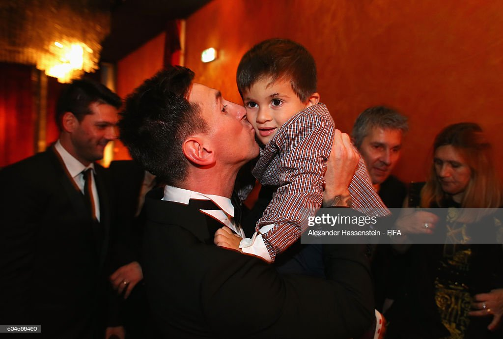 Ballon d'Or winner Lionel Messi of Argentina and Barcelona kisses his son Thiago after the FIFA Ballon d'Or Gala 2015 at the Kongresshaus on January 11, 2016 in Zurich, Switzerland.
