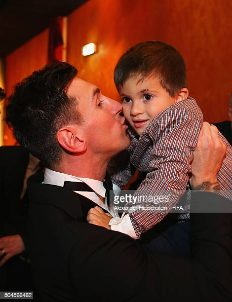Ballon d'Or winner Lionel Messi of Argentina and Barcelona kisses his son Thiago after the FIFA Ballon d'Or Gala 2015 at the Kongresshaus on January...