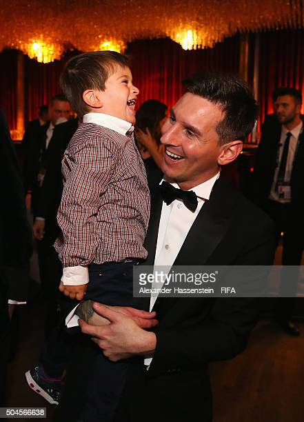Ballon d'Or winner Lionel Messi of Argentina and Barcelona laughs with his son Thiago after the FIFA Ballon d'Or Gala 2015 at the Kongresshaus on...