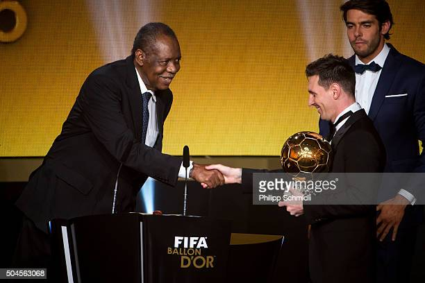 Ballon d'Or winner Lionel Messi of Argentina and FC Barcelona is congratulated by acting FIFA President Issa Hayatou during the FIFA Ballon d'Or Gala...