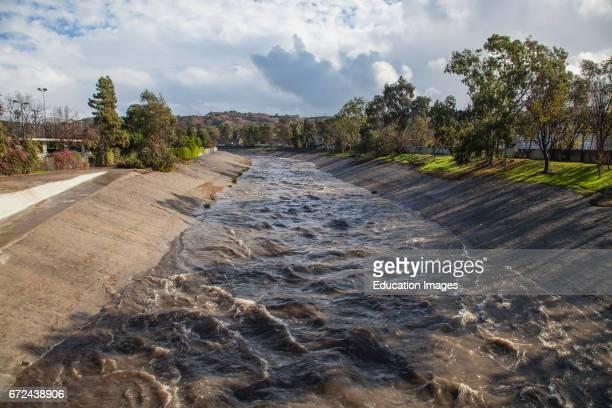 Ballona Creek rises dramatically after rainfall Culver City Los Angeles California USA