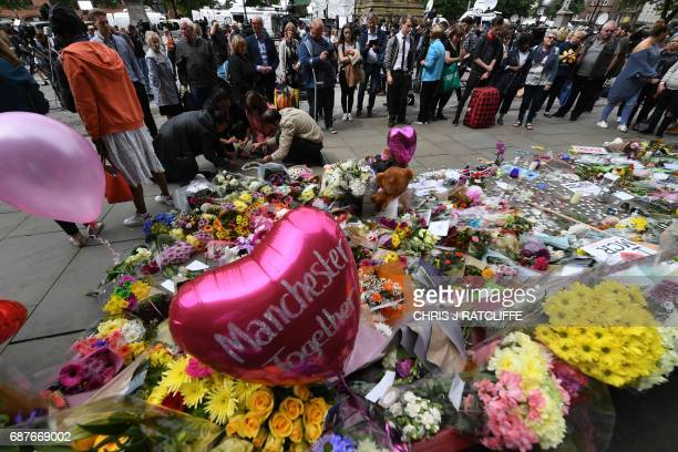 Ballons and flowers are seen in Albert Square in central Manchester northwest England on May 24 placed in tribute to the victims of the May 22 terror...