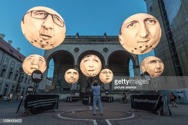 Ballons bearing the faces of the G7 members showing Japanese Prime Minister Shinzo Abe French President Francois Hollande Italian Prime Minister...