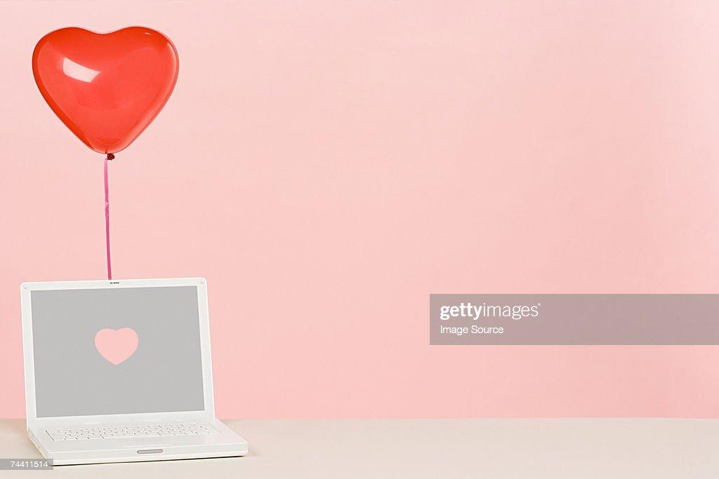 Balloon and laptop : Stock Photo