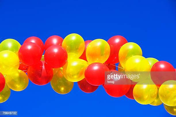 Balloon arch under blue sky