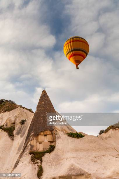 Balloon at sunrise over the cave settlement in Cappadocia, Turkey