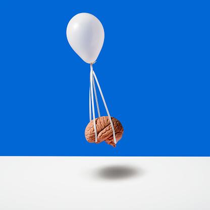 Balloon carrying brain - gettyimageskorea