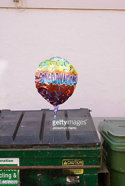 balloon caught on dumpster - jessamyn harris stock pictures, royalty-free photos & images