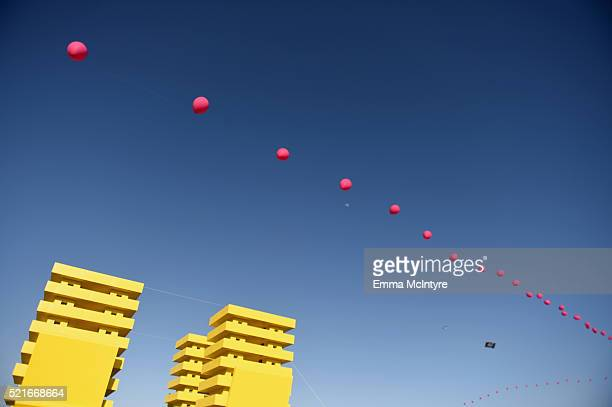 A balloon chain floats above art installation Katrina Chairs by Alexandre Arrechea during day 2 of the 2016 Coachella Valley Music Arts Festival...