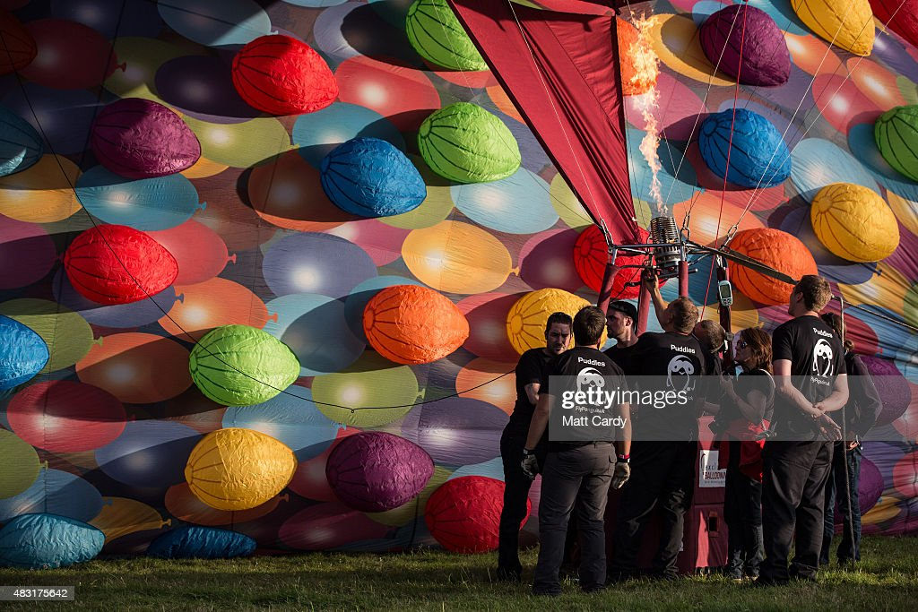 A balloon crew inflate their balloon in the main arena on the first day of the Bristol International Balloon Fiesta at the Ashton Court estate on August 6, 2015 in Bristol, England. Now in its 37th year, the Bristol International Balloon Fiesta is Europe's largest annual hot air balloon event in the city that is seen by many balloonists as the home of modern ballooning.