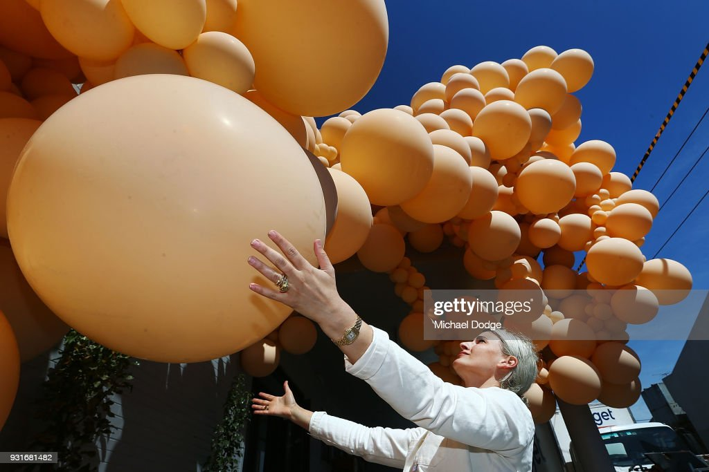 Balloon designer Jihan Zencirli, aka Geronimo, attends to her installation for Melbourne Design Week 2018 on March 14, 2018 in Melbourne, Australia. The installation is Zencirli's first ever public Australian creation, using 5000 balloons to cover the 39m facade.
