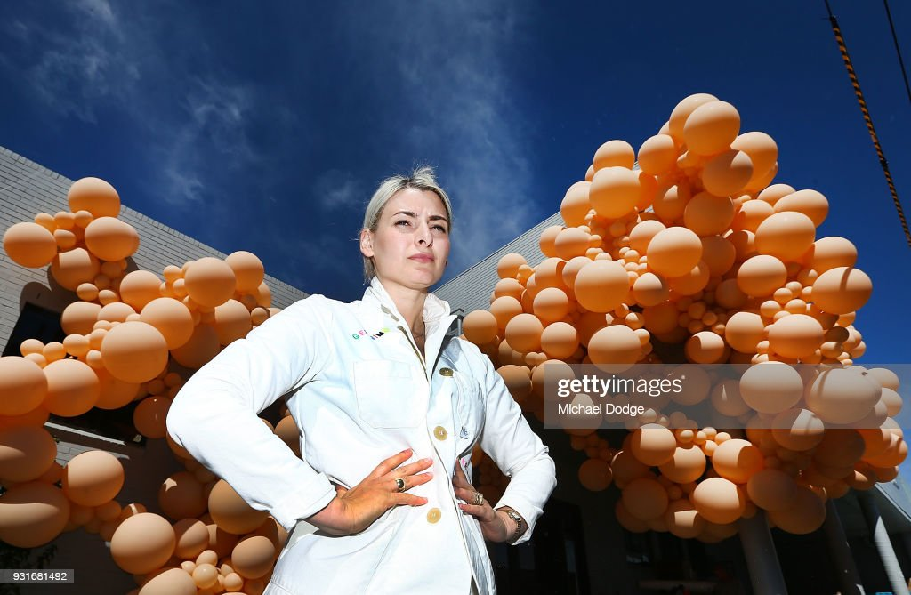 Balloon designer Jihan Zencirli, aka Geronimo, poses with her installation for Melbourne Design Week 2018 on March 14, 2018 in Melbourne, Australia. The installation is Zencirli's first ever public Australian creation, using 5000 balloons to cover the 39m facade.