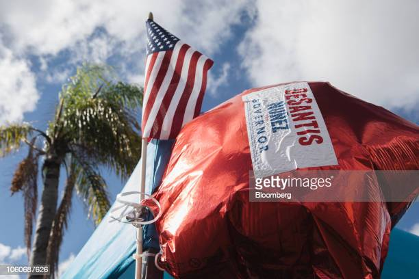 A balloon displays a campaign sticker for Ron DeSantis Republican candidate for governor of Florida next to an American flag outside the Broward...