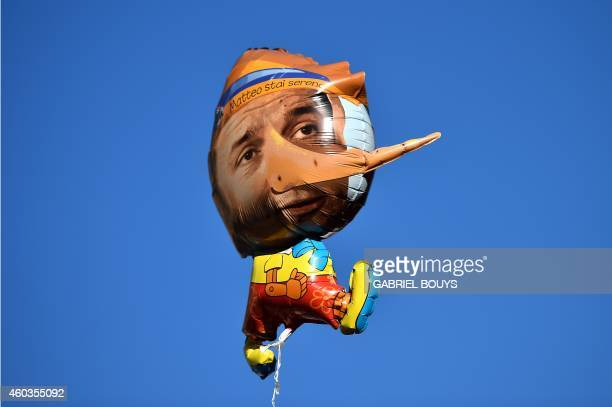 A balloon featuring Italian Prime minister Matteo Renzi as Pinocchio is displayed during a general strike called by several trade union organisations...
