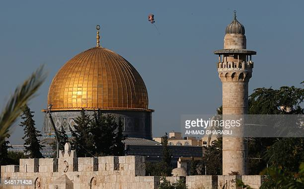 A balloon flies near the Dome of Rock at the AlAqsa Mosque compound Islam's third most holy site in the old city of Jerusalem on July 6 2016 Muslims...