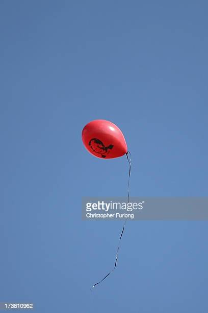 A balloon floats outside the Mediclinic Hospital as people celebrate the 95th birthday of their 'Father of the Nation' Nelson Mandela on July 18 2013...