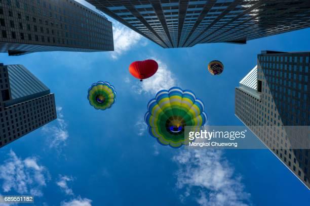Balloon flying over modern building