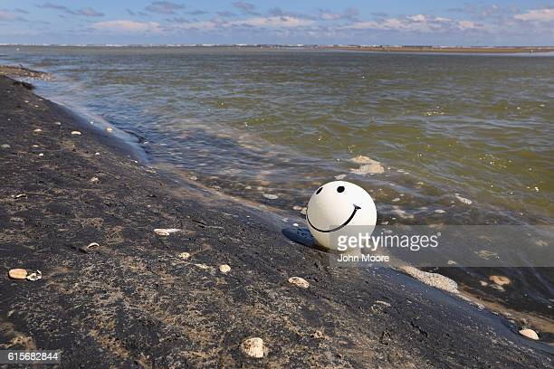 A balloon from a Mexican family beaches on the American side of the mouth of the Rio Grande on October 19 2016 in Boca Chica Texas The mouth of the...