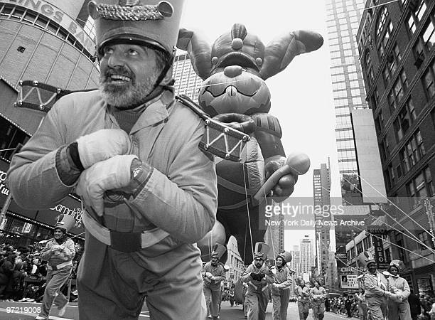 A balloon handler tries to keep a grip on the Quick Bunny during the Thanksgiving Day Parade in Times Square