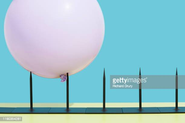 balloon impaled on metal spikes - the end stock pictures, royalty-free photos & images