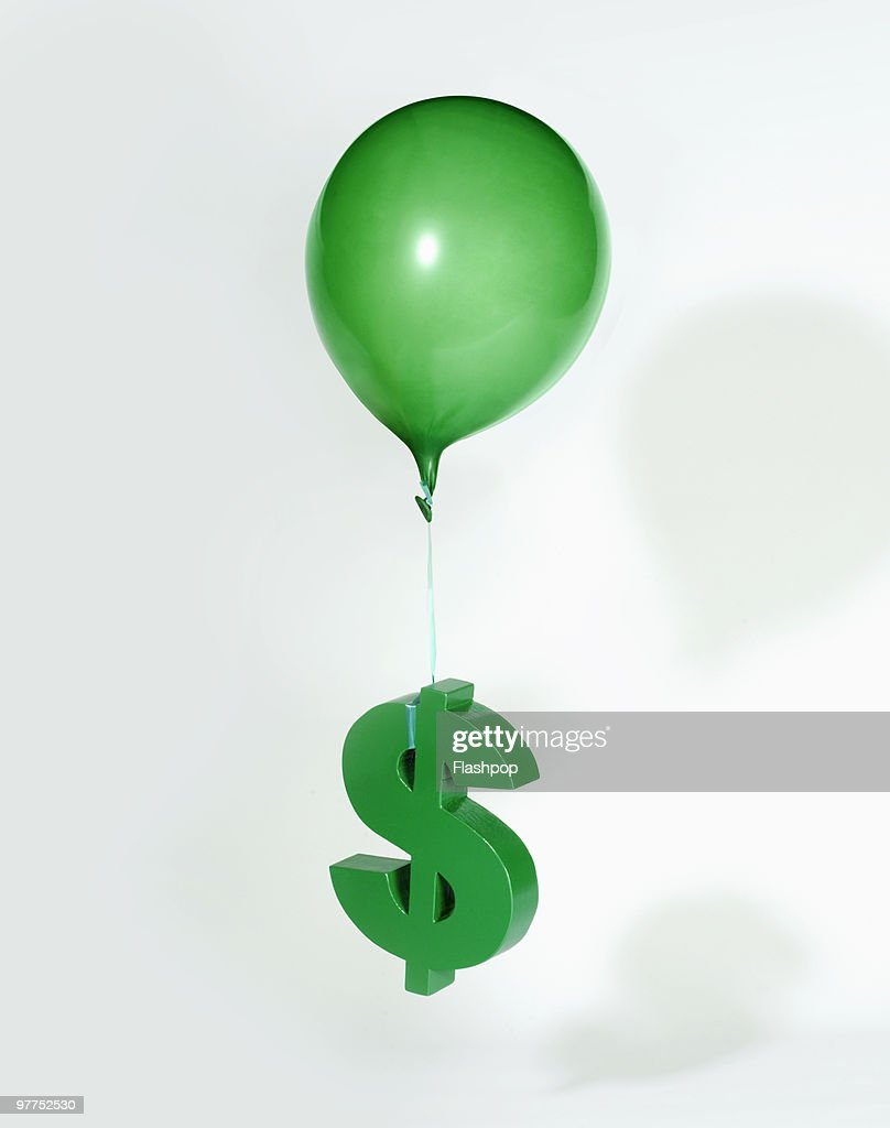 Balloon lifting Dollar sign  : ストックフォト