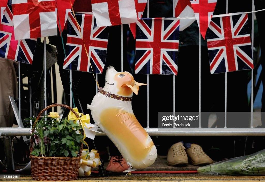 A balloon of a Corgi dog is seen as people gather near Windsor Castle on April 21, 2006 in Windsor, England. HRH Queen Elizabeth II will take part in her traditional walk in the town later today to celebrate her 80th Birthday. In the evening the Prince of Wales will host a private party for The Queen and other members of the Royal family at Kew Palace.