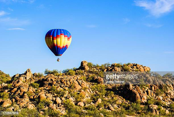 balloon over sonora dessert - sonoran desert stock pictures, royalty-free photos & images