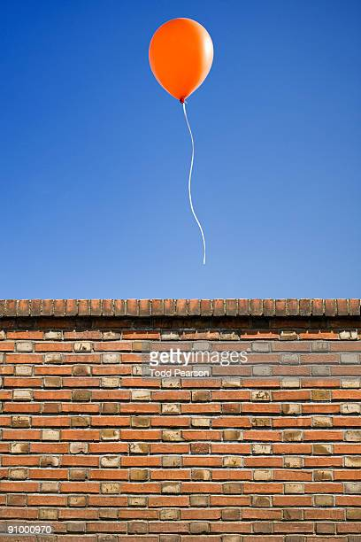 balloon over the wall - releasing stock pictures, royalty-free photos & images