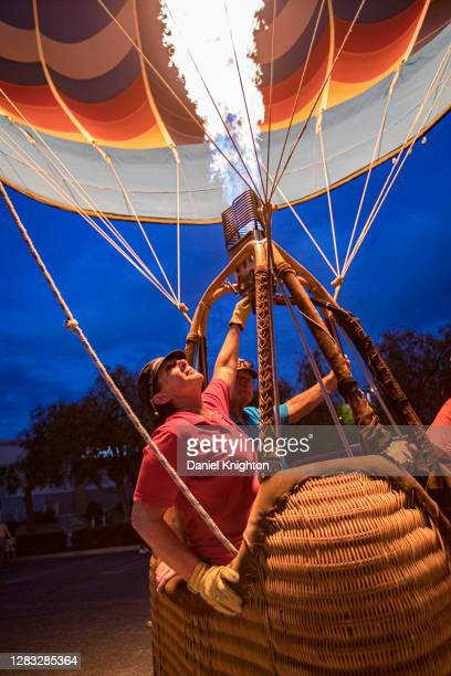 Balloon owner Sandy Graham fires the burner of her balloon Instagraham at the Hot Air Halloween Balloon Glow on October 31, 2020 in Temecula,...