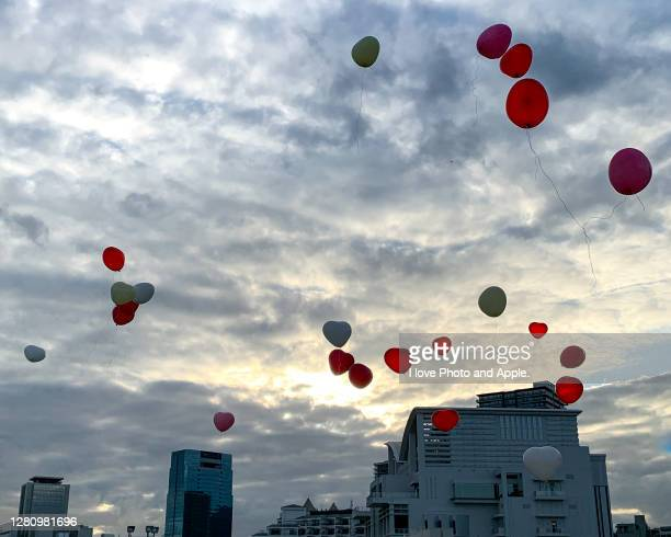 balloon release - releasing stock pictures, royalty-free photos & images
