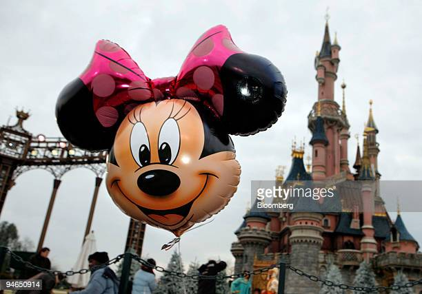 A balloon representing Minnie Mouse floats in front of Cinderella's Castle at Disneyland Resort Paris the amusement park run by Eurodisney near Paris...