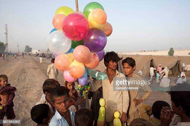 A balloon seller in he camp set up for families displaced by the flooding that is run by the Pakistan military in Sukkar The floods in Pakistan have...