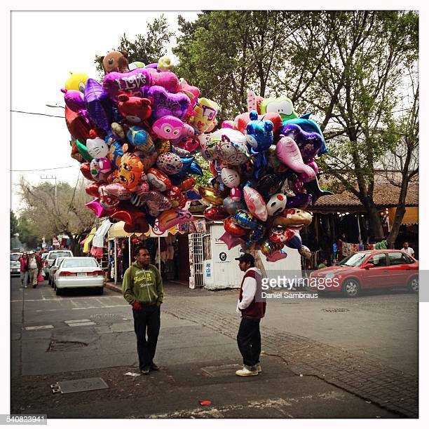 Balloon sellers on the streets of Coyoacan Mexico City Mexico